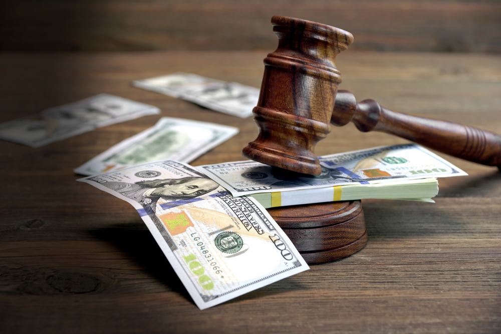 Picture of money and a gavel.