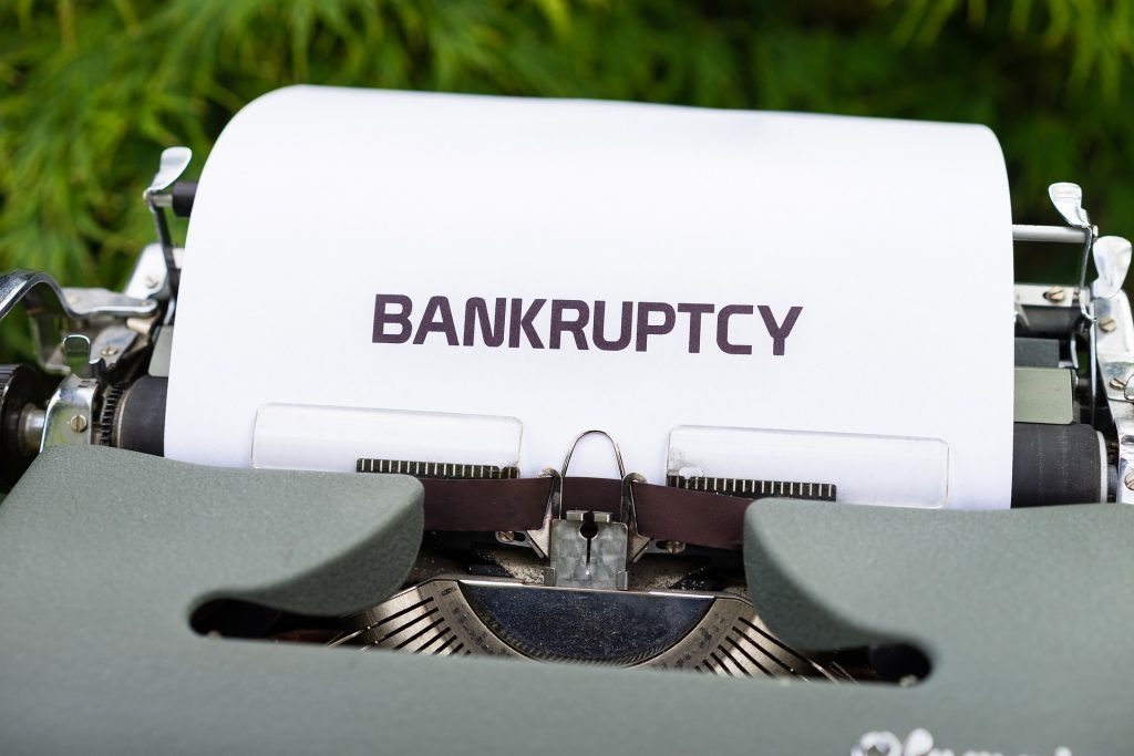 "Picture of a typewriter and paper that reads, ""Bankruptcy."""